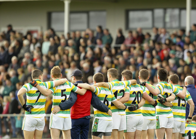 Players of Carbery Rangers stand for the national anthem before the game