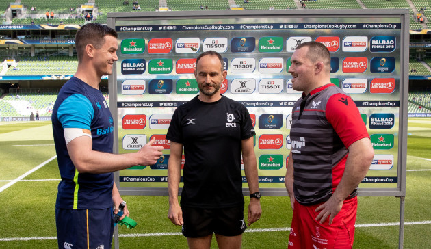 Ken Owens and Jonathan Sexton with referee Romain Poite during the coin toss