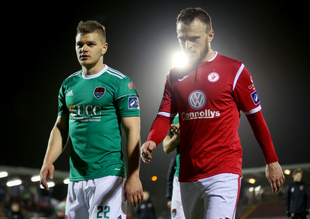 Sean McLouglin and David Cawley leave the pitch after the game
