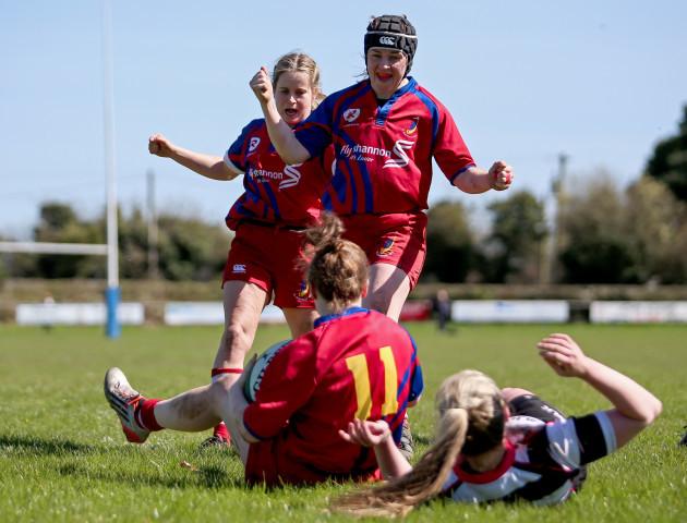 Laura Sheehan, Fiona Reidy and Laura O'Mahony celebrate a try