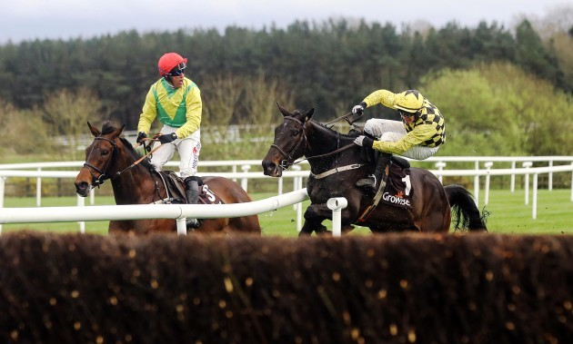 Paul Townsend onboard Al Boum Photo forces Robbie Power onboard Finian's Oscar off the track as they approach the last jump