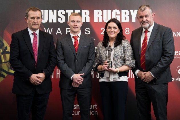 Keith Earls, Garrett Fitzgerald and Niall O'Donovan present Olive Foley on behalf of Anthony Foley with the Hall Of Fame Award