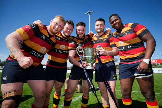 Martin Mulhall, Greg McGrath, Tyrone Moran, James Rael and Ntinga Mpiko celebrate with the trophy after the game