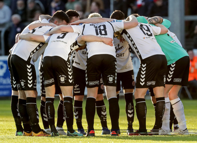 The Bohemians team huddle ahead of the game