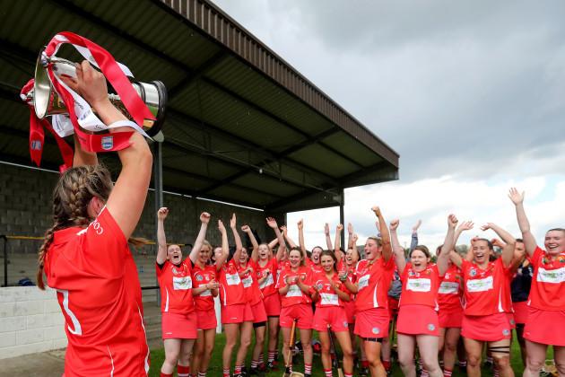 Sarah Harrington lifts the League 2 Trophy