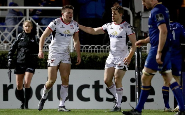 Jacob Stockdale celebrates scoring a try with Andrew Trimble