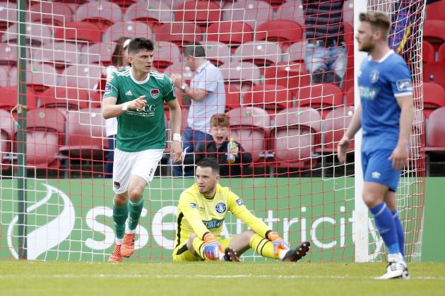 Graham Cummins scores a goal