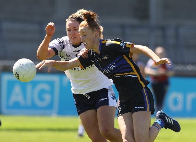 Grainne McGlade tackles Aisling Moloney