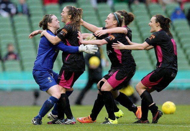 Mary Rose Kelly celebrates with her teammates after wining the penalty shoot-out