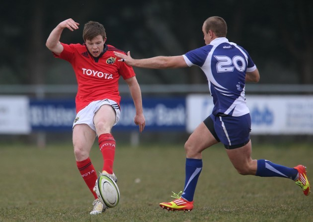 Munster's Jonny Holland clears under pressure