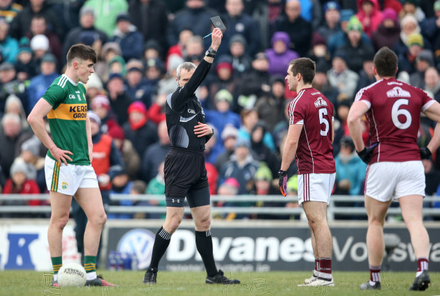Cathal Sweeney is shown a black card by Fergal Kelly