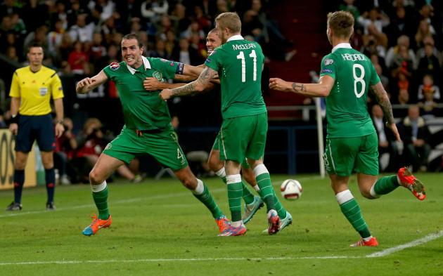 John O'Shea celebrates scoring a late equaliser against Germany