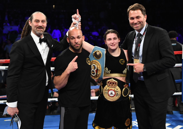 Katie Taylor celebrates with her trainer Ross Enamaitin and Eddie Hearn