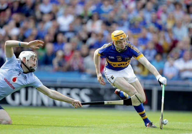 Lar Corbett scores a goal despite the attention of Pater Kelly