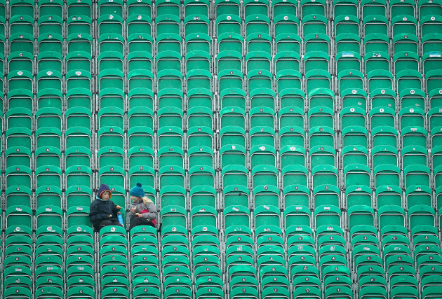 Young fans endure the rain during a pitch inspection
