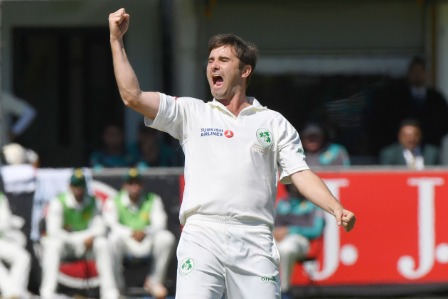 Tim Murtagh celebrates after taking the wicket of Imam-ul-Haq