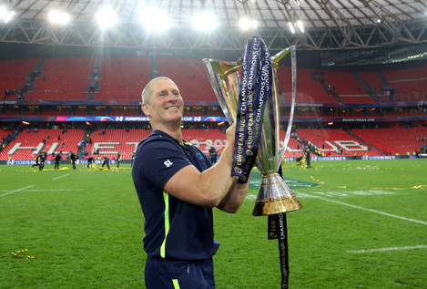 Stuart Lancaster celebrates with the European Rugby Champions Cup trophy