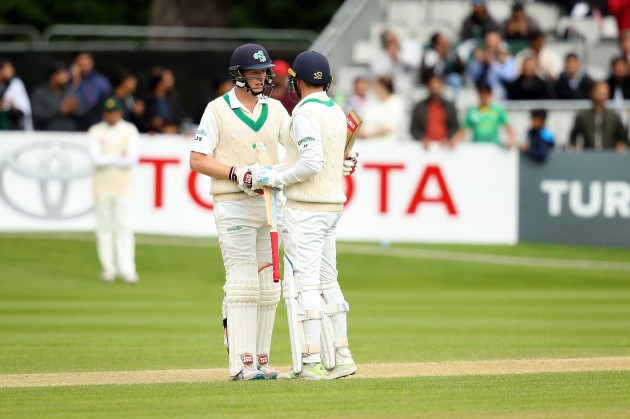 Kevin O'Brien congratulates Stuart Thompson on his half century