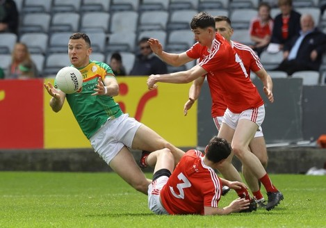 Darragh Foley gets the ball away under pressure