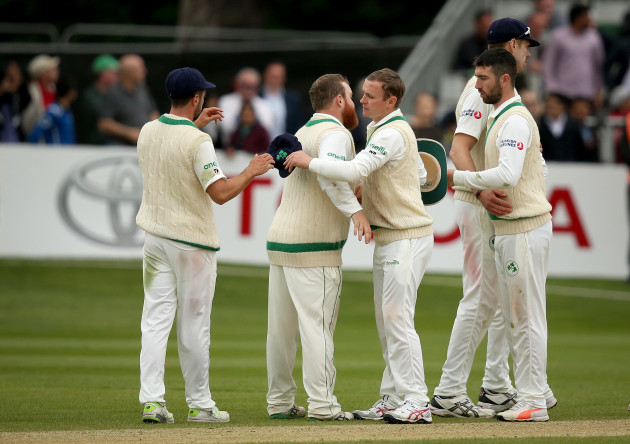 Paul Stirling and William Porterfield embrace after the game
