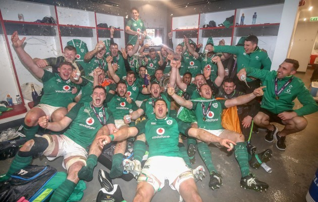 The Ireland team celebrate winning the Grand Slam
