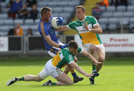Sean Pender and Conor Carroll tackle Rory Finn