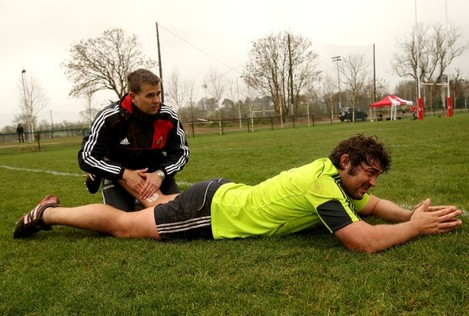 Tony Buckley is treated by physio Anthony Coole