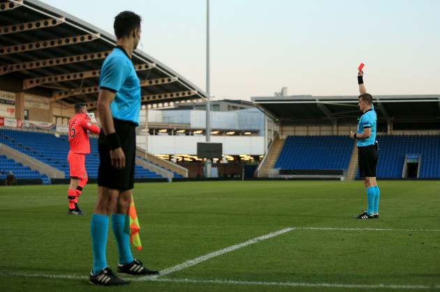 James Corcoran is shown a red card by Zbynek Proske during the shoot out