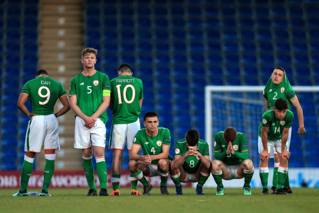 The Ireland team dejected after losing the game on penalties