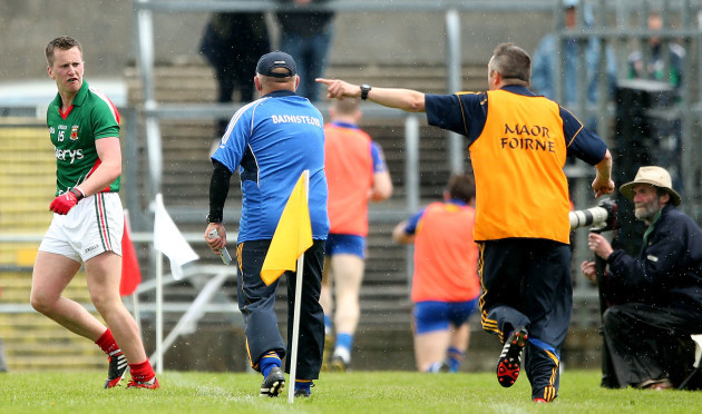 Cillian O'Connor has words with manager John Evans during the second half