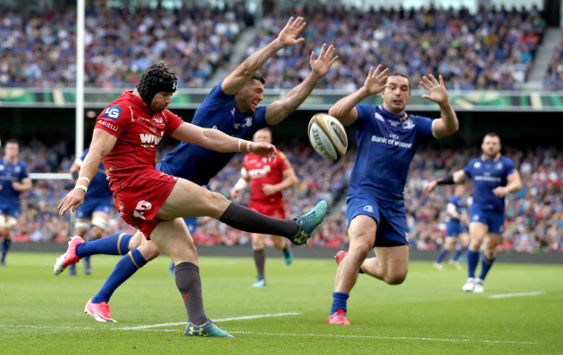 Leigh Halfpenny clears under pressure from Rob Kearney and James Lowe
