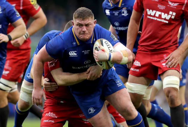 Tadhg Furlong tackled by Ken Owens