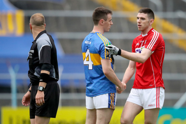 Alan Campbell shakes hands with Luke Connolly of Cork after the game
