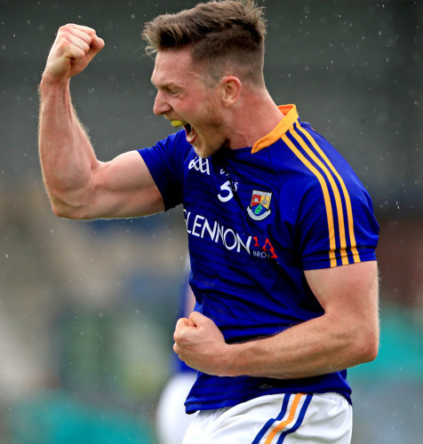 Michael Quinn celebrates at the final whistle