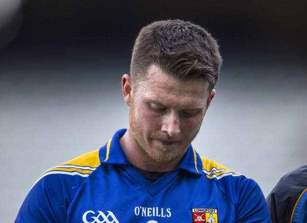 A dejected Michael Quinn