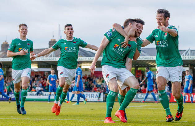Garry Buckley celebrates scoring his sides opening goal with Barry McNamee and Alan Bennett