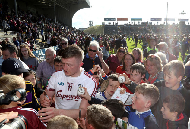 Joe Canning signs autographs for fans after the game