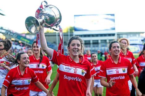 Ciara O'Sullivan raises the trophy in the air as the team celebrates