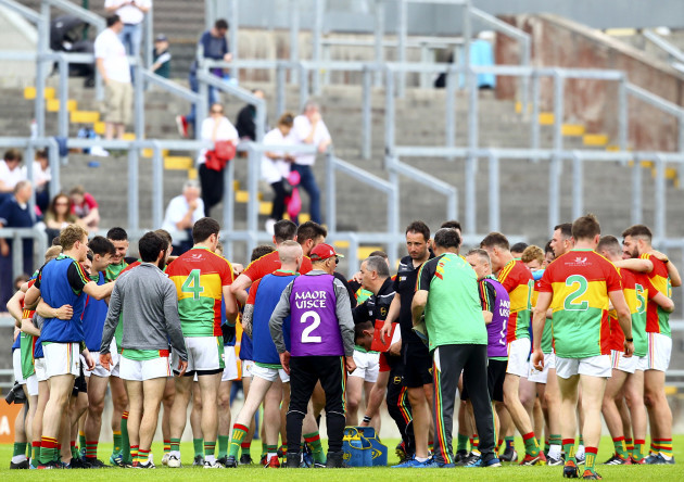 Turlough O'Brien, gathers his team on the pitch at half time
