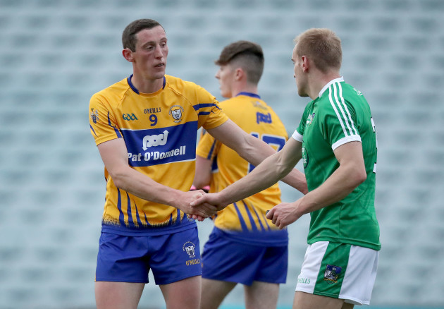 Sean O'Dea shakes hands with Cathal O'Connor after the game