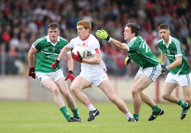 Peter Harte gets away from Stephen Cahill and Cian Sheehan