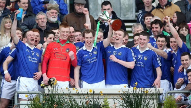 Seanie Buckley lifts the Division 4 trophy with teammates