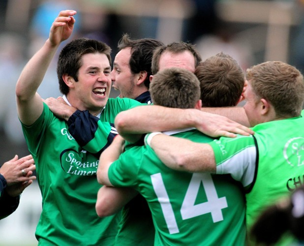 John Riordan celebrates with teammates at the final whistle