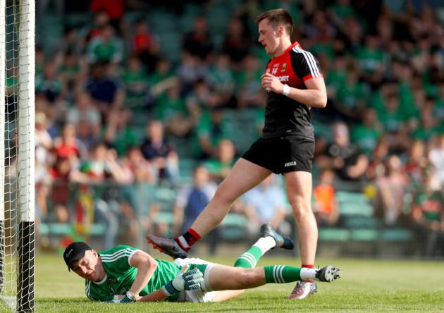 Cillian O'Connor scores a goal despite Donal O'Sullivan