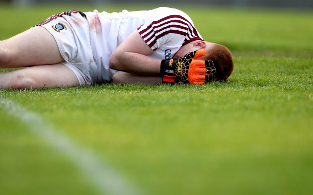 Kevin Fagan dejected after spilling the ball into his own goal