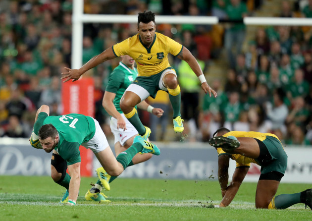 Robbie Henshaw tackled by Will Genia and Marika Koroibete
