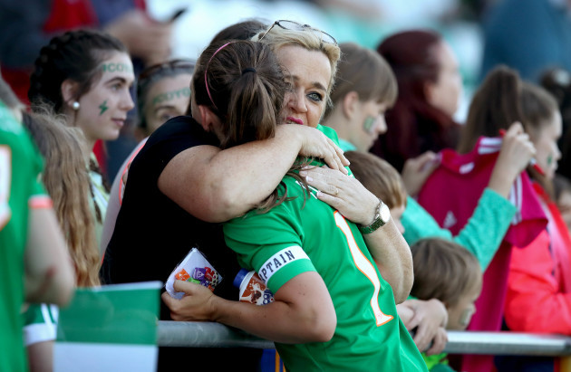 Katie McCabe is consoled after the game