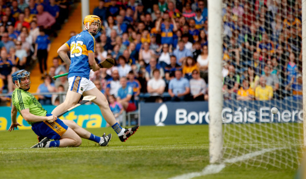 Jake Morris shots past goalkeeper Donal Tuohy only for his shot to hit the post