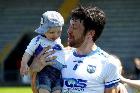 Tommy Prendergast celebrates after the game with his son Tom