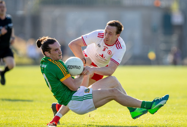 Cillian O'Sullivan is brought down by Colm Cavanagh
